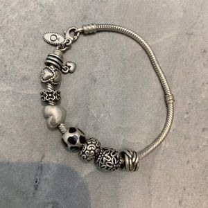 Pandora bracelet + 8 charms (best offer)
